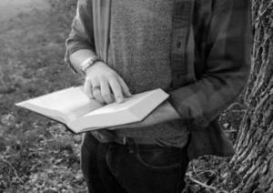 Cowboy Poetry reading a poem -- free-use-photo-unsplash-by-Cassidy-Kelley