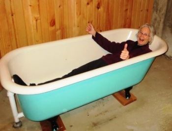Linda testing the new cast iron clawfoot tub 2017