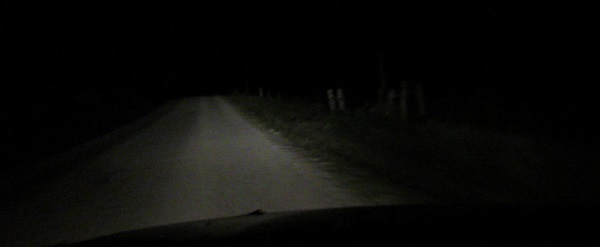 Darkness headlights on gravel road